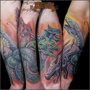 meilleur-tatoueur-paris-pierre-gilles-romieu-tatouage-noeud-dragons-couleurs-tattoo