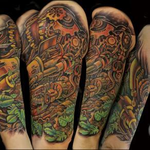 Pierre-Gilles Romieu_la_bete_humaine_paris_tattoo_couleur_biomecanique_vegetation_bras